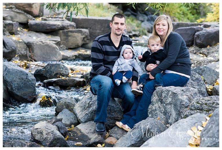 Family photo by a rocky stream